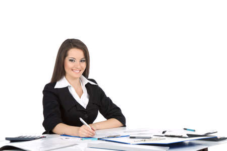 law office: young happy businesswoman in elegant suit sitting at desk Stock Photo