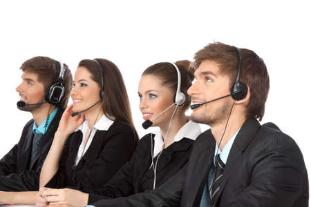Smiling young businesspeople and colleagues in call center Stock Photo