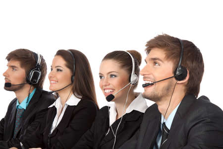 telephone headsets: Smiling young businesspeople and colleagues in call center Stock Photo