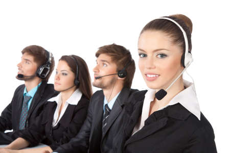 Smiling young businesswoman and colleagues in a call center photo