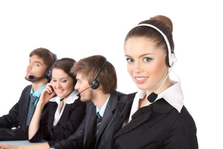 Smiling young businesswoman and colleagues in a call center Stock Photo - 10636995