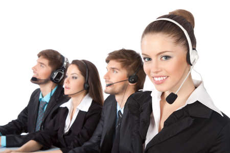 Smiling young businesswoman and colleagues in a call center Stock Photo - 10637004