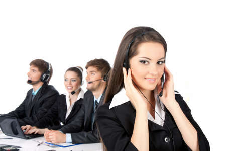 contact center: Smiling positive young businesswoman and colleagues in a call