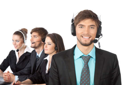 handsome young businessman and colleagues in call center photo