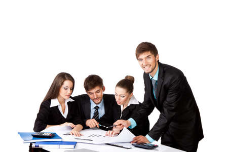 young business people sitting at desk working photo