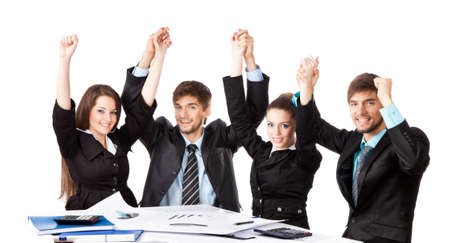 young business people sitting at desk holding hands up photo