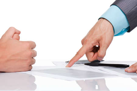 Business men hands at the desk over white background photo