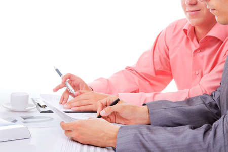 business men sitting at the desk working photo