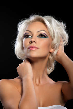 beautiful girl with make up and hairstyle over black Stock Photo - 10748336