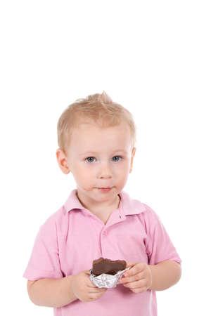 Little boy holding chocolate bar over white background Stock Photo - 10748226