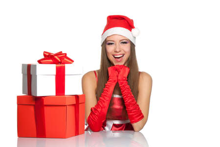 christmas girl wearing red santa hat over white background photo