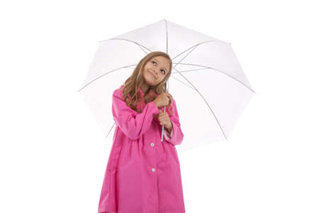 little teenage girl in pink coat with umbrella over white photo