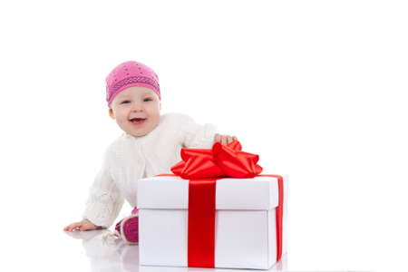 year child with gift box over white background photo