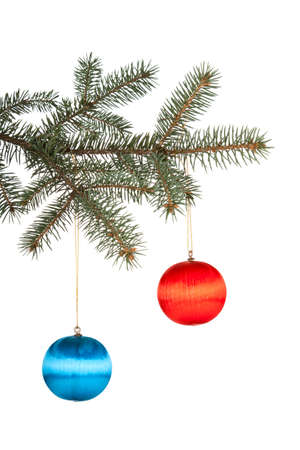 Christmas ball with curly ribbon on christmas tree photo