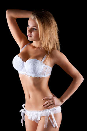 sexy breast: blond woman in lingerie looking to the side smiling Stock Photo