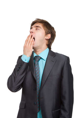 Handsome young business man yawning, businessman cover mouth by hand photo