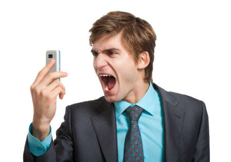 Angry business man screaming on cell mobile phone photo