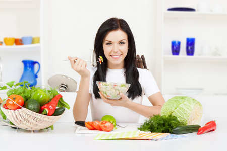 diet woman: young woman cooking on her kitchen happy smile