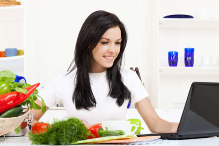 young woman cooking on her kitchen happy smile Stock Photo - 13044402