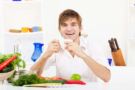 young man cooking on kitchen happy smile photo