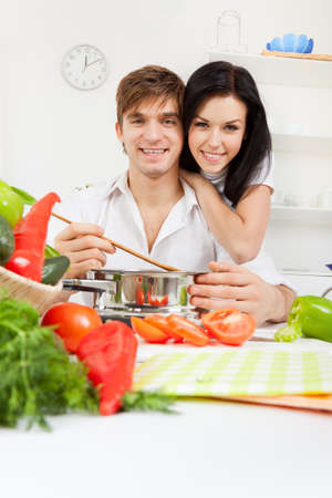 young lovely couple in their kitchen coocking happy smile Stock Photo - 13044270