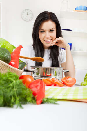 young woman cooking on her kitchen happy smile Stock Photo - 13044365