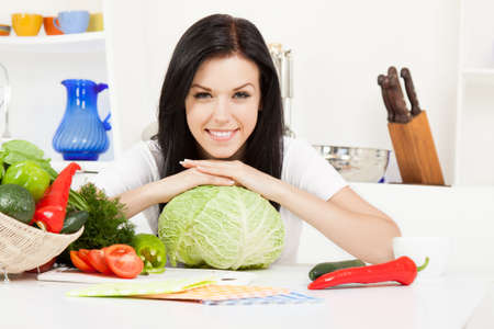 young woman cooking on her kitchen happy smile Stock Photo - 13044370