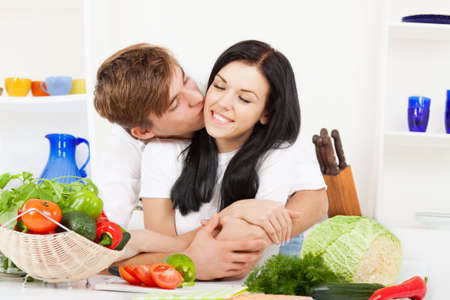 young lovely couple in their kitchen coocking happy smile Stock Photo - 13044421
