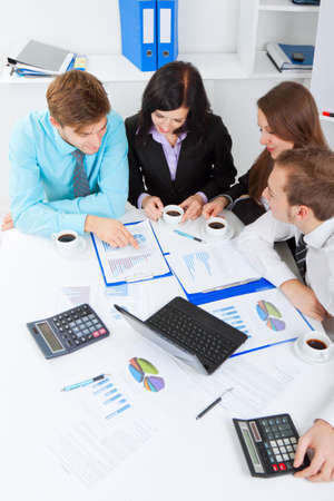 boardroom meeting: young business people in office at the desk