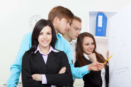 young business people in office at the desk Stock Photo - 13079064
