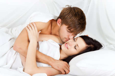 young lovely couple lying in a bed, happy smile Stock Photo - 13175779
