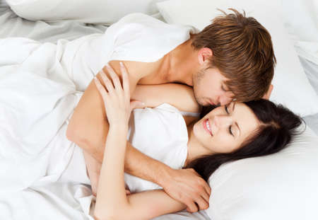 young lovely couple lying in a bed, happy smile Stock Photo - 13175749