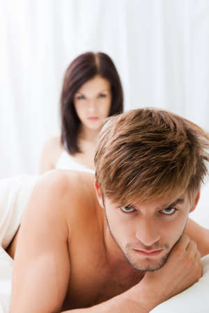 affairs: young couple lying in bed problem, conflict Stock Photo
