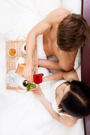 beautiful young happy couple lying in bed Stock Photo - 13175823