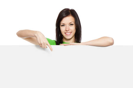 smile woman standing hold pointing her finger at a blank board Stock Photo