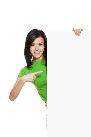 smile woman standing hold pointing her finger at a blank board Imagens