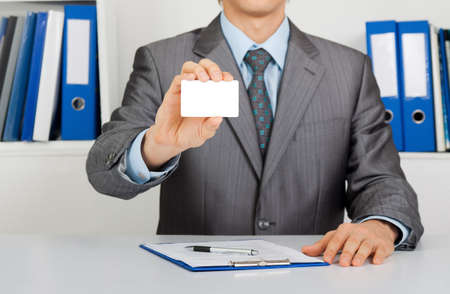 Businessman sitting at the desk at office photo