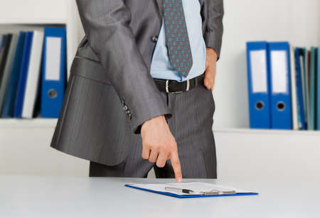 Businessman at the desk at office photo