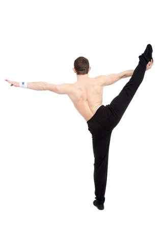 caucasian man acrobatics gymnastic doing a exercise athletic sportsman photo