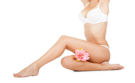 Beautiful female body white panties pink flower long leg Stock Photo