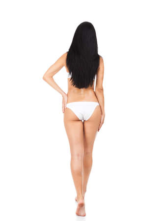 Rear view back of young beautiful woman brunette in panties full length isolated over white background. concept of perfect body figure photo