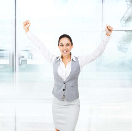 Business woman excited hold hands up raised arms photo