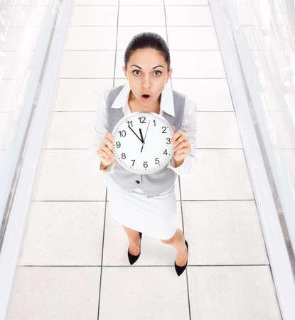 Businesswoman clock worried photo