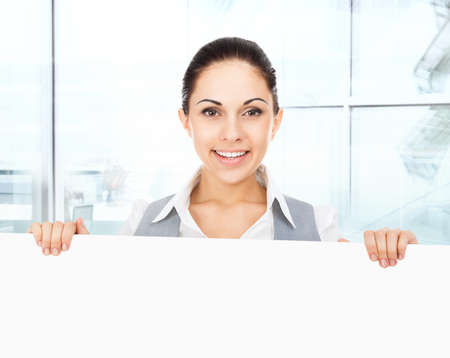businesswoman holding a blank white card board photo