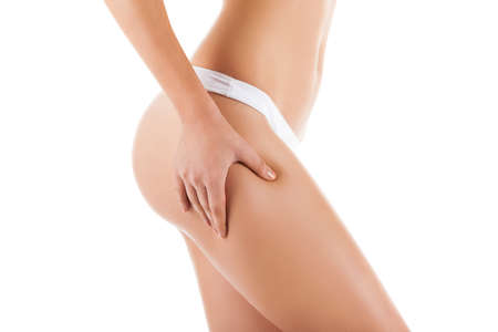 cellulite: Checking cellulite, woman hip, female body