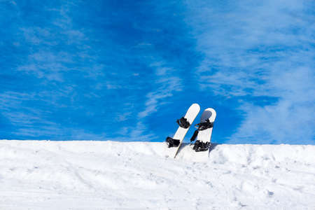 two snowboard in snow mountain slope photo