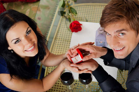 marriage proposal, man give ring to his girl photo