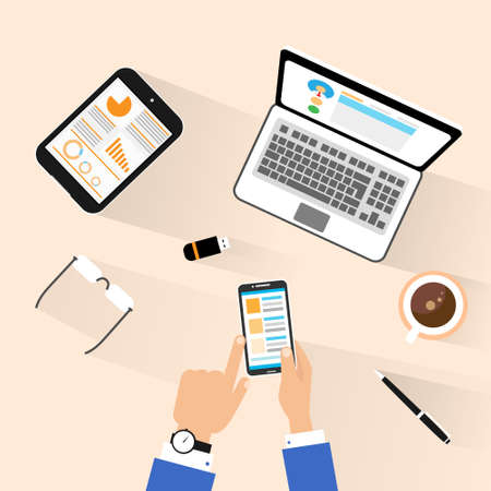 businessman use phone at workplace top above view desk