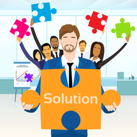 leader lead: Business People Group Hold Jigsaw Puzzle Piece Concept