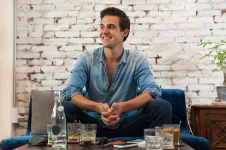 cafe: Handsome Man Smile Sitting at Cafe Table Stock Photo